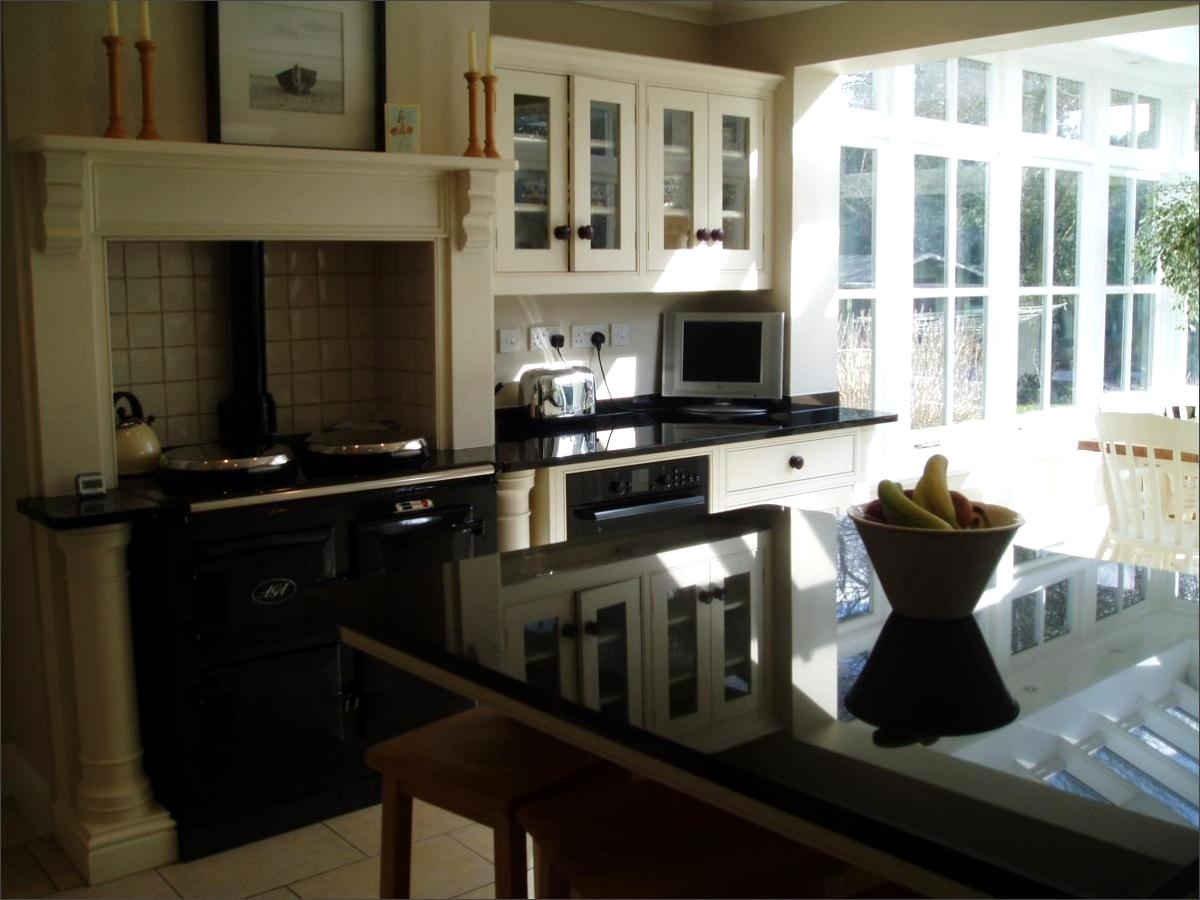 Image Of Absolute Black Granite Island, Oven And Kitchen Dresser