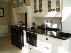 Image Of Absolute Black Granite Kitchen Dresser And Oven