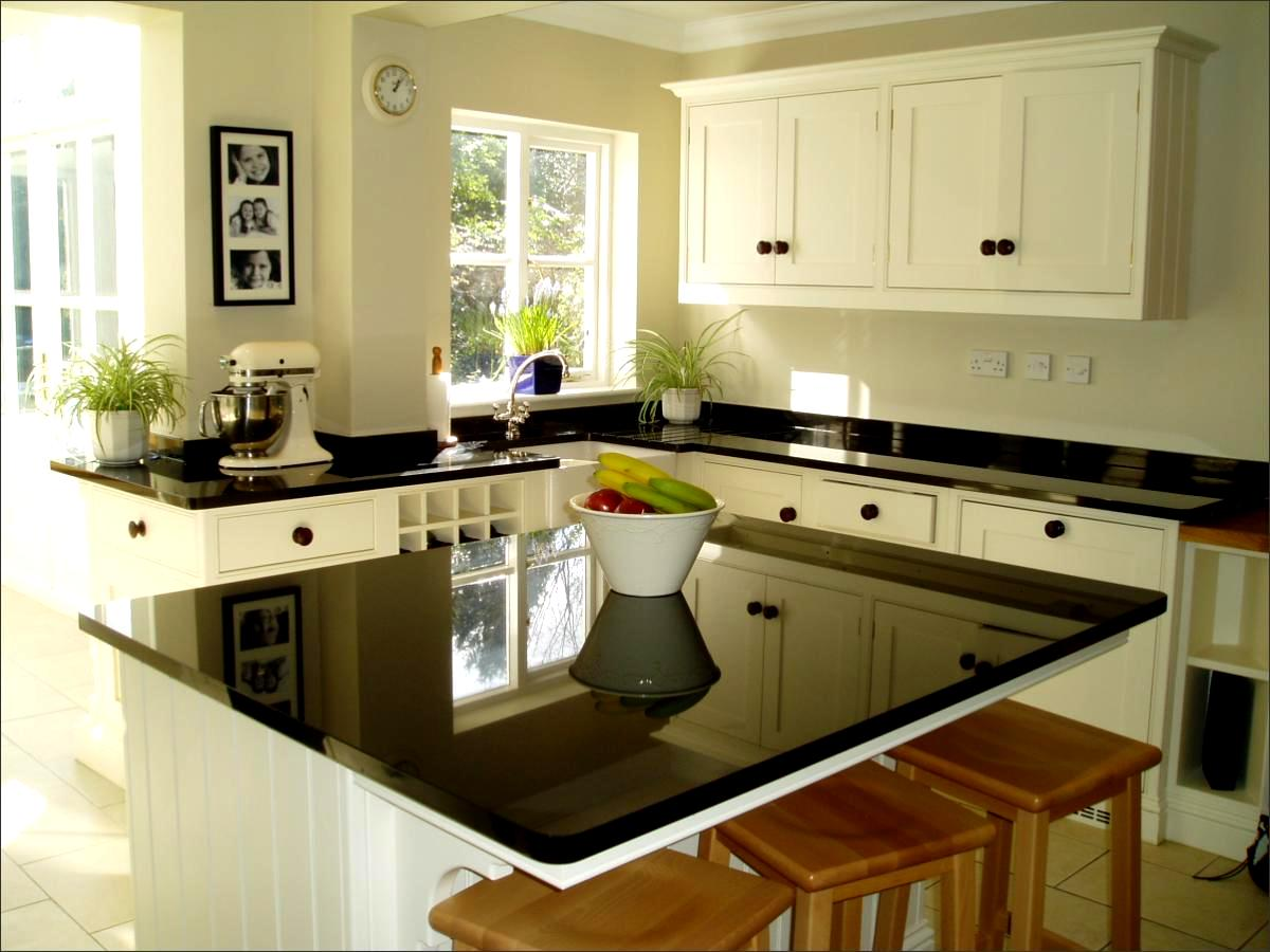 Absolute black granite worktops island and splashbacks
